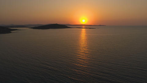 Scenic Big sun at sunset over calm sea in Greece Live Action