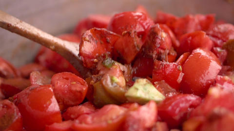 Cooking tomato sauce close-up. Cook add fresh tomato in pan, slow motion Live Action