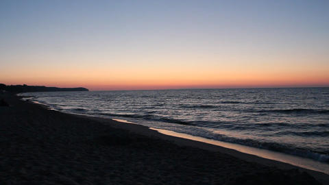 Baltic Sea coast during scarlet sunset Live Action