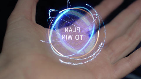 Plan to win text hologram on a female hand Live Action