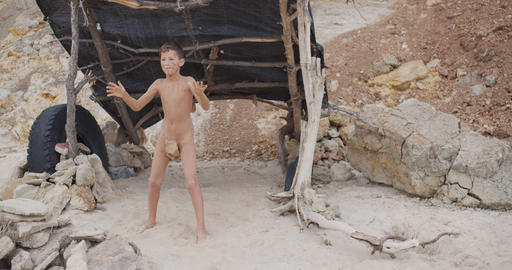 Caveman, manly boy dancing . Funny young primitive boy outdoors. Prehistoric Live Action