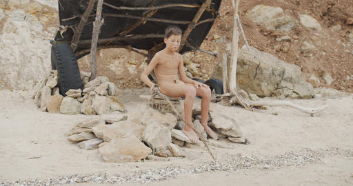 Caveman, manly boy. Funny young primitive boy outdoors. Evolution survival Live Action