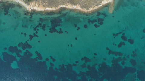 Top view rocky coast with clear sea in Lemnos,Greece Footage