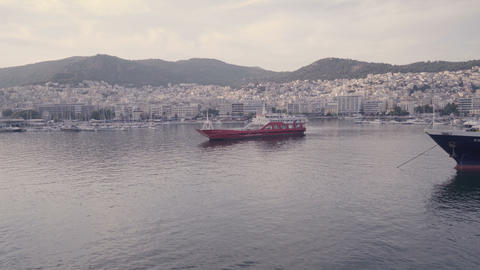 Horizontal view of Kavala docks in Greece. Red yacht staying still in calm Live Action