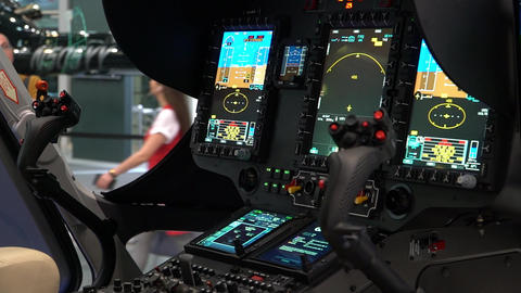 Demonstration of the instrument panel of the helicopter with two control levers Live Action