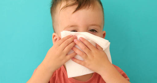 Child blows his nose Live Action
