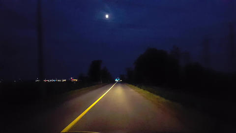 Driving Through Rural Countryside Approaching City Lights on Horizon. Driving Point of View POV Live Action