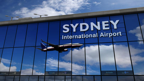 Airplane landing at Sydney, Australia mirrored in terminal Live Action