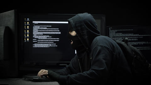 Hacker Infiltrating Computer for Code Information Live Action