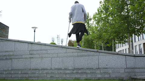 Skill man with one leg on crutches doing flip in the street. Disabled person ライブ動画