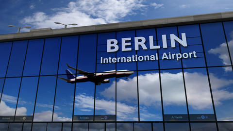 Airplane landing at Berlin Germany mirrored in terminal Live Action