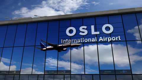 Airplane landing at Oslo, Norway mirrored in terminal Live Action