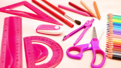 Pink school supplies for girls disappear and appear on the table - Stop motion animation Animation