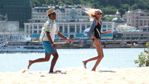 Happy couple playing and running on beach shore Footage