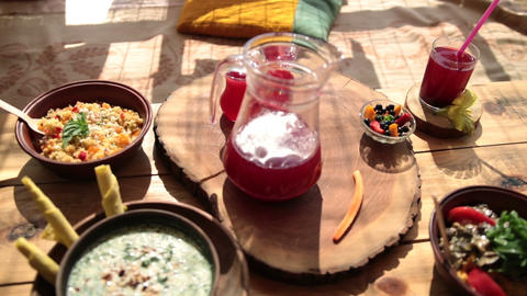 Closeup of vegetarian food on rustic wooden table Live Action