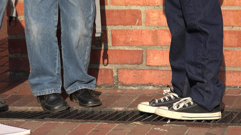 Shoes Of Young Boys Standing Live Action
