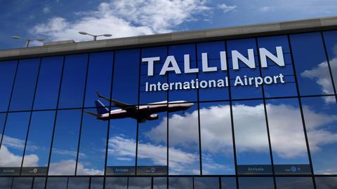 Airplane landing at Tallinn, Estonia mirrored in terminal Live Action