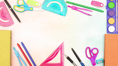 Stop motion animation of school supplies make frame for your title and disappear from the table Animation