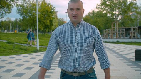 Energetic and aggressive man walking forward Footage