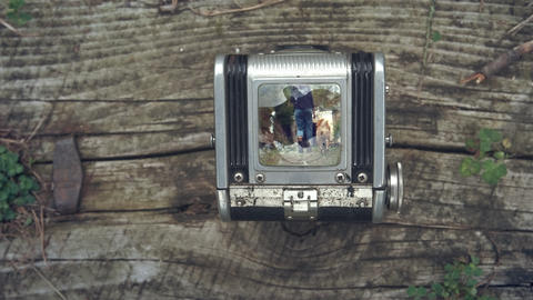 First person view through vintage TLR Twin lens reflex camera viewfinder. Old Footage