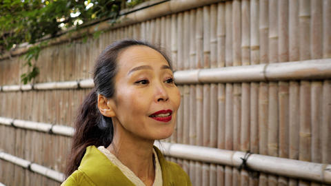Elegant Japanese woman enjoying a walk in Kyoto Japan Footage
