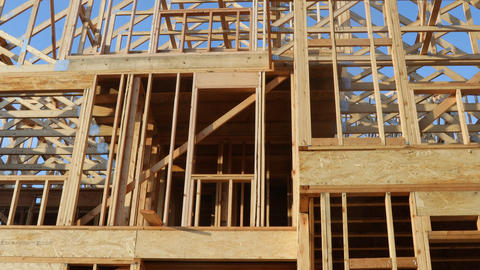 Wood home framing at construction site Live Action