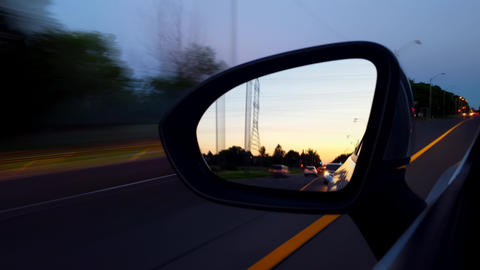 *Motion Blur Version* Driving Left Side Mirror During the Evening. Driver Point of View POV Side Live Action