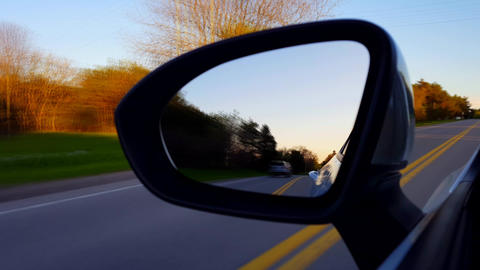 *Motion Blur Version* Driving Rural Road View of Side Mirror at Sunset. Driver Point of View POV Live Action