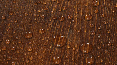 Brown wooden texture background in raindrops. Rotation.... Stock Video Footage