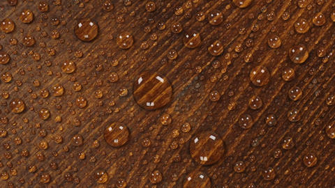 Brown wooden texture background in raindrops. Rotation. Brown wety wood surface Live Action