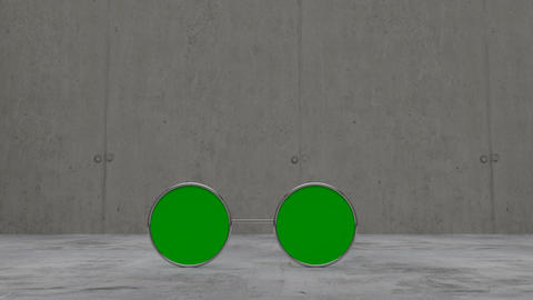 Green screen sun glasses laying on concrete floor Animation