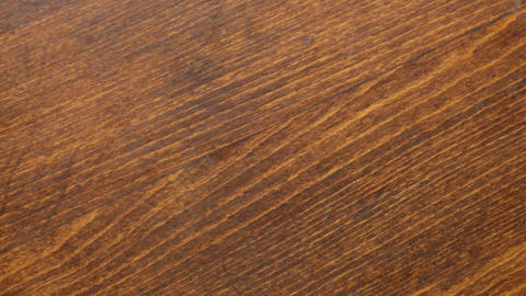 Brown wooden texture background. Rotation. Brown wood surface Live Action