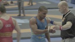 The referee raises the winner's hand in wrestling. Champion, winner, leadership Live Action