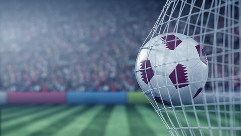 Flag of Qatar on the ball in football net. Conceptual 3D animation GIF