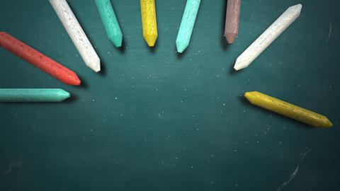 Closeup colorful chalk on blackboard, school background of education theme Animation