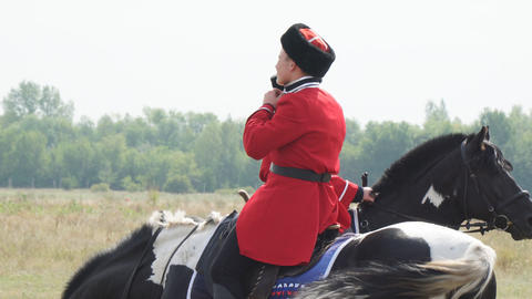 Cossacks in traditional Cossack uniform on horseback Footage
