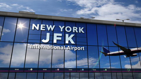 Airplane landing at New York, JFK, Kennedy mirrored in terminal Live Action
