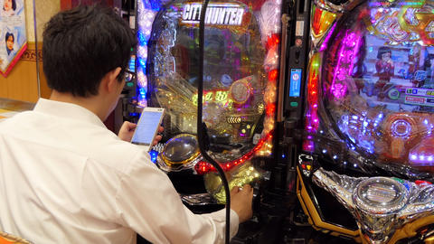 Young Man Playing Pachinko Lottery Game In Tokyo Japan Asia Footage