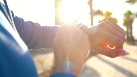 Smartwatch. Woman using smart watch. Closeup of female touching touch screen on Live Action