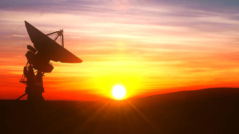 Radio telescope explores evening sky against scenic sunset Animation