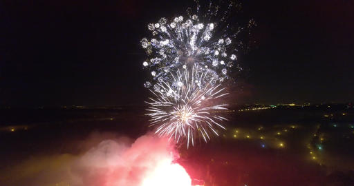 An aerial view of a huge beautiful firework in a pitch black sky Footage
