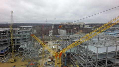 An aerial view of a huge construction site against the bare forest and dull sky Footage