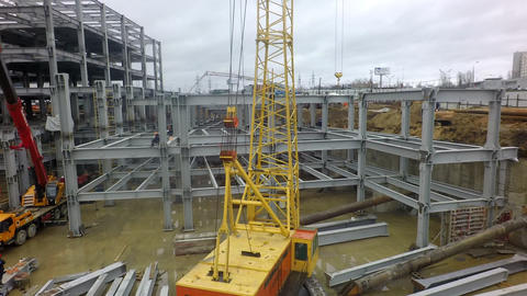 A vertical inspection of a construction crane against the building frame and a Footage