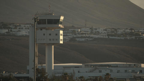 An observation tower in the rays of evening sun against the mountain slopes Footage