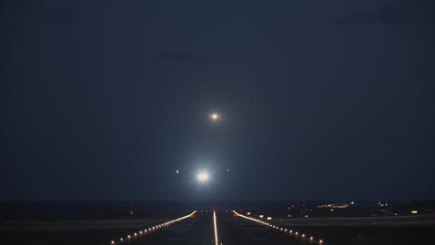 A night view of a runway with a taking off plane Footage