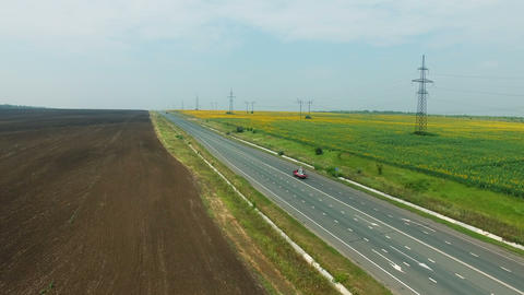Aerial footage of road and transport, people traveling by cars on a freeway Footage