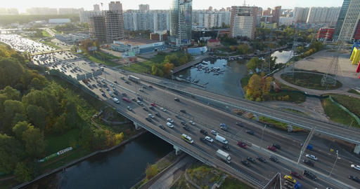 An aerial view of a busy highway above the river in the middle of the city Footage