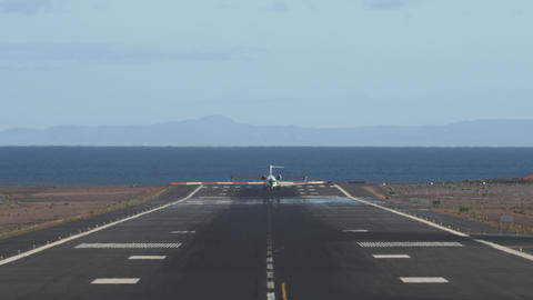 Airliner taking off. Scenic runway overlooking sea and mountains Footage