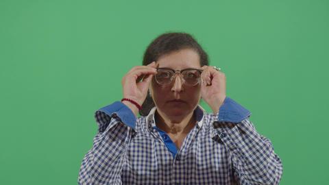 Woman Putting On Prescription Glasses Live Action