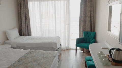 Two comfortable beds for three person in cozy bedroom in resort hotel. Hotel Footage